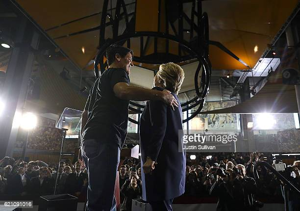 Democratic presidential nominee former Secretary of State Hillary Clinton greets businessman Mark Cuban during a campaign rally at The Great Hall at...
