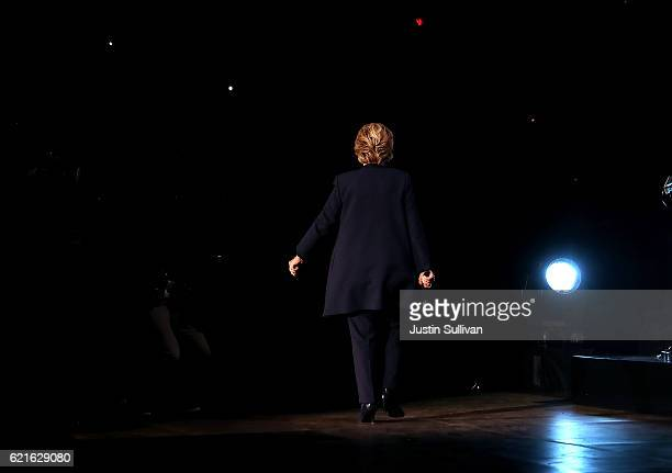 Democratic presidential nominee former Secretary of State Hillary Clinton walks off stage during a Get Out The Vote concert at Wolstein Center on...