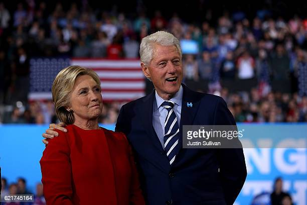 Democratic presidential nominee former Secretary of State Hillary Clinton and her husband former US President Bill Clinton look on during a campaign...