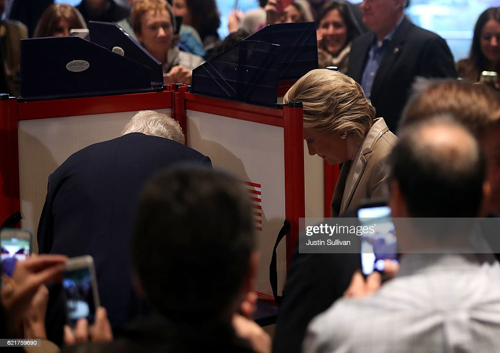 Democratic presidential nominee former Secretary of State Hillary Clinton (R) and her husband former U.S. President Bill Clinton vote at Douglas Grafflin Elementary School on November 8, 2016 in Chappaqua, New York. Hillary Clinton cast her ballot in the presidential election as the rest of America goes to the polls to decide between her and Republican presidential candidate Donald Trump.