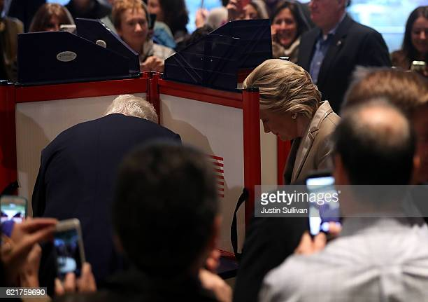 Democratic presidential nominee former Secretary of State Hillary Clinton and her husband former US President Bill Clinton vote at Douglas Grafflin...