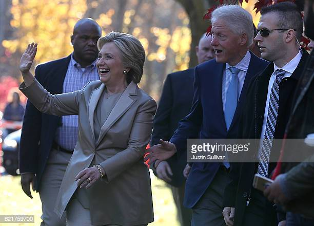 Democratic presidential nominee former Secretary of State Hillary Clinton and her husband former US President Bill Clinton greet supporters after...