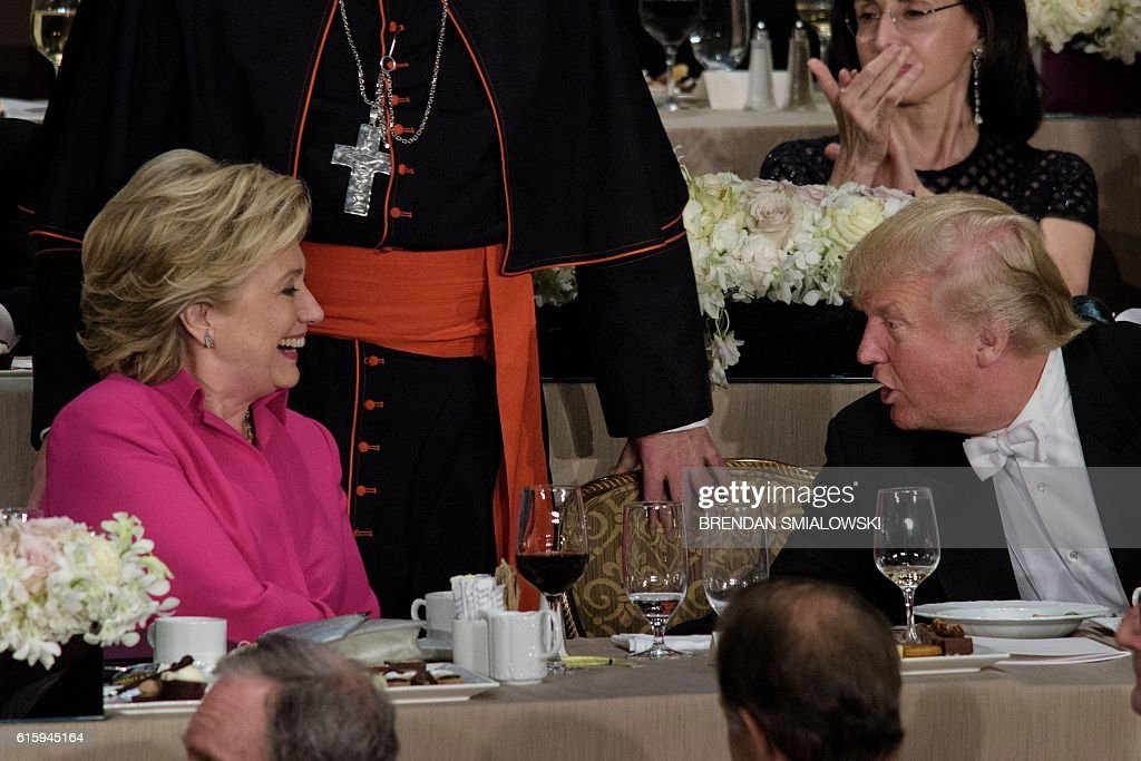 TOPSHOT - Democratic presidential nominee Hillary Clinton (L) and Republican presidential nominee Donald Trump shake hands after speaking during the Alfred E. Smith Memorial Foundation Dinner at Waldorf Astoria October 20, 2016 in New York, New York. / AFP / Brendan Smialowski