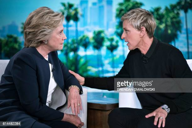 TOPSHOT Democratic presidential nominee Hillary Clinton and tv host Ellen DeGeneres talk during a commercial break of the taping of the Ellen Show on...