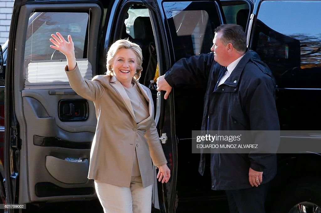 Democratic presidential nominee Hillary Clinton arrives vote in Chappaqua, New York on November 8, 2016. After an exhausting, wild, bitter, and sometimes sordid campaign, Americans finally began voting Tuesday for a new president: either the billionaire populist Donald Trump or Hillary Clinton, seeking to become the first woman to win the White House. / AFP / EDUARDO