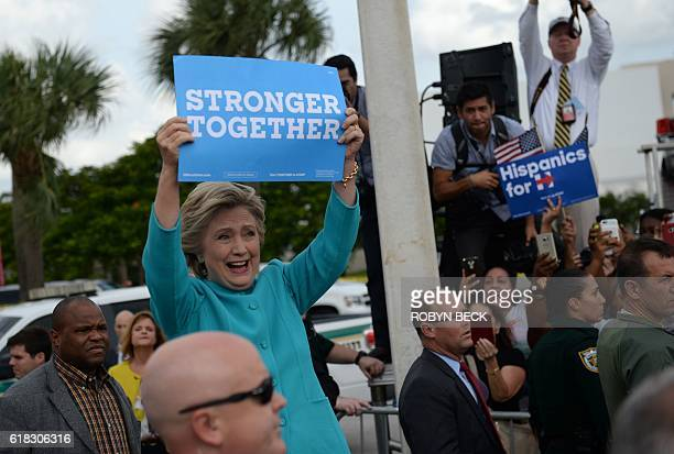 Democratic presidential nominee Hillary Clinton attends a rally at Palm Beach State College in Lake Worth Florida October 26 2016 / AFP / Robyn BECK