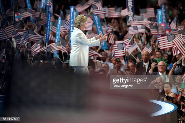 Democratic presidential nominee Hillary Clinton gives two thumbs up to the crowd as she arrives on stage during the fourth day of the Democratic...