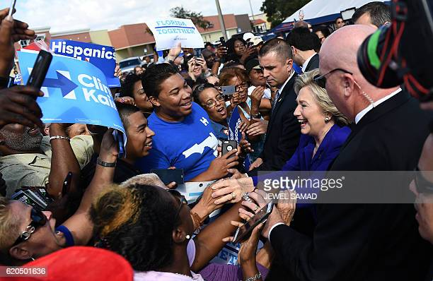 US Democratic presidential nominee Hillary Clinton greets supporters outside an early voting center in Lauderhill Florida on November 2 2016 / AFP /...