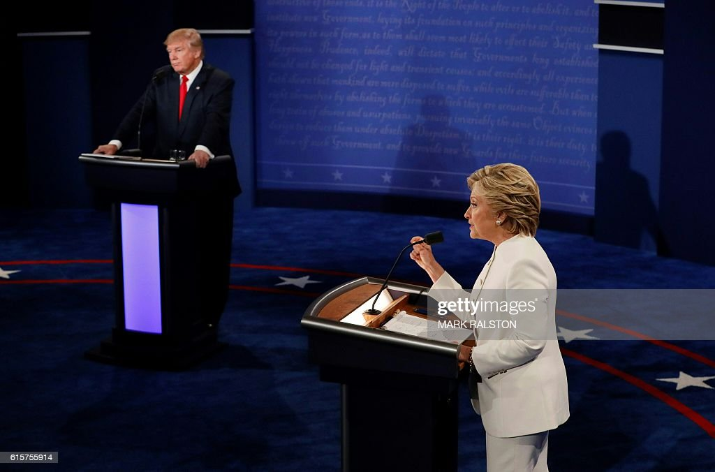 TOPSHOT - Democratic presidential nominee Hillary Clinton (R) speaks as Republican presidential nominee Donald Trump looks on during the final presidential debate at the Thomas & Mack Center on the campus of the University of Las Vegas in Las Vegas, Nevada on October 19, 2016. / AFP / Mark RALSTON
