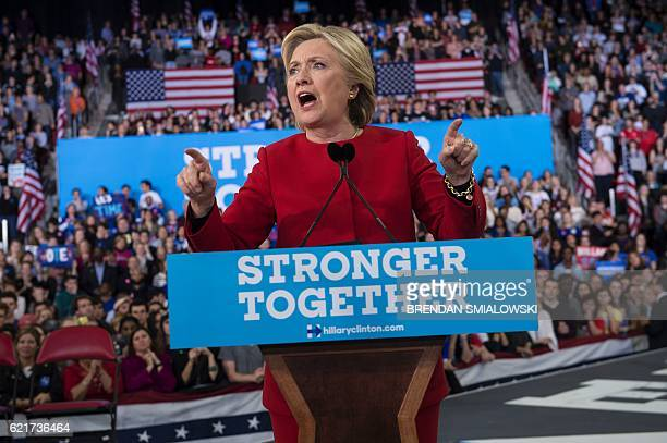 TOPSHOT Democratic presidential nominee Hillary Clinton speaks during a midnight rally at Reynolds Coliseum November 8 2016 in Morrisville North...