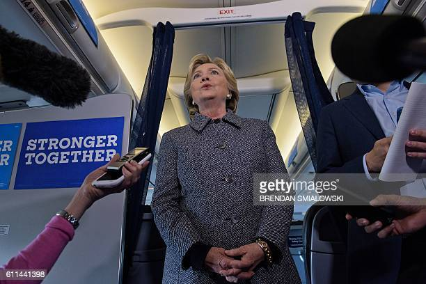 Democratic presidential nominee Hillary Clinton speaks to the press on her plane at Chicago Midway Airport September 29 2016 in Chicago Illinois /...