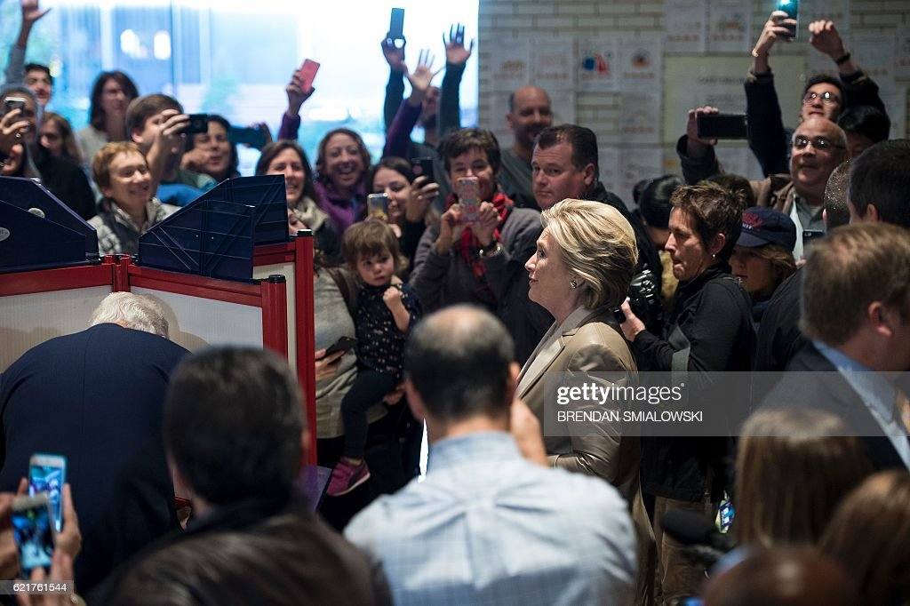 Democratic presidential nominee Hillary Clinton steps away from a voting booth after voting at Douglas G. Griffin School November 8, 2016 in Chappaqua, New York. / AFP / Brendan Smialowski