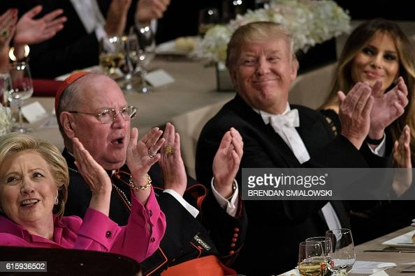 Democratic presidential nominee Hillary Clinton Timothy Cardinal Dolan Archbishop of New York Republican presidential nominee Donald Trump and...