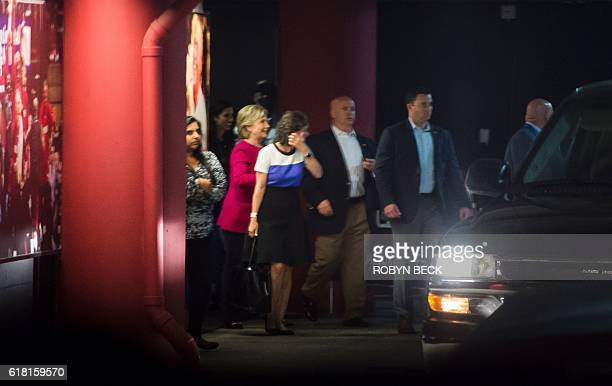 Democratic presidential nominee Hillary Clinton walks to her motorcade after attending a concert by recording artist Adele at the American Airlines...