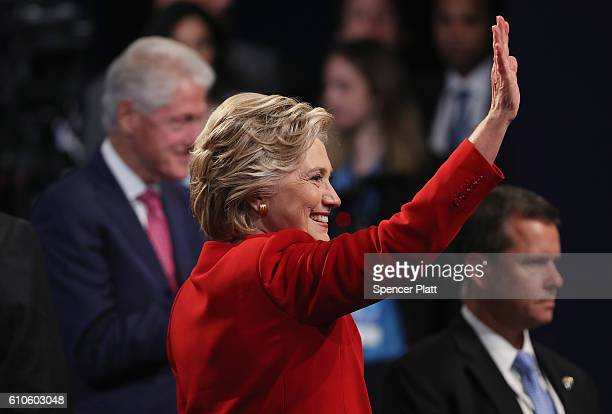 Democratic presidential nominee Hillary Clinton waves after the Presidential Debate with Republican presidential nominee Donald Trump at Hofstra...