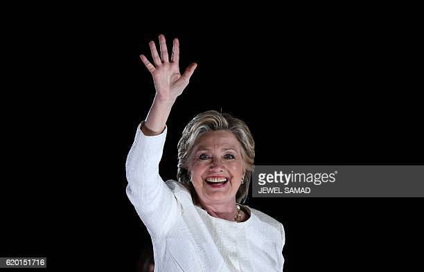 US Democratic presidential nominee Hillary Clinton waves to supporters during a campaign rally in Sanford Florida on November 1 2016 With one week to...