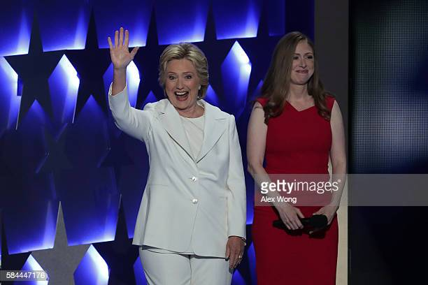 Democratic presidential nominee Hillary Clinton waves to the crowd after being introduced by her daughter Chelsea Clinton on the fourth day of the...