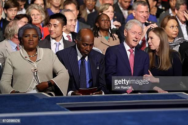 Democratic presidential nominee Hillary Clinton's husband and former US President Bill Clinton talks with daughter Chelsea Clinton during the...