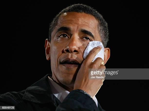 Democratic presidential nominee US Sen Barack Obama wipes away tears as he cries while speaking about his grandmother during a rally at University of...