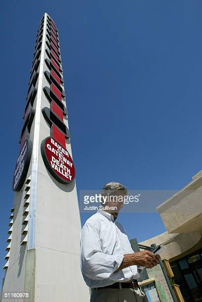 Democratic presidential nominee US Sen John Kerry reads a brochure as he walks past the worlds biggest thermometer August 11 2004 in Baker California...