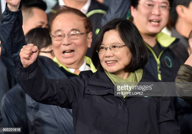 Democratic Progressive Party presidential candidate Tsai Ingwen gestures as she celebrates her victory inTaipei on January 15 2016 Voters in Taiwan...