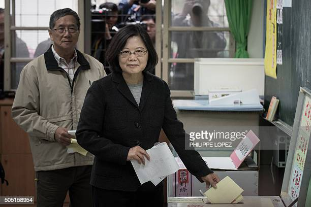 Democratic Progressive Party presidential candidate Tsai Ingwen casts her vote in New Taipei City on January 16 2016 Polls opened in Taiwan with the...