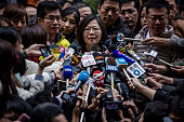 Democratic Progressive Party presidential candidate Tsai Ingwen talks to journalists after casting her ballot at a polling station on January 16 2016...