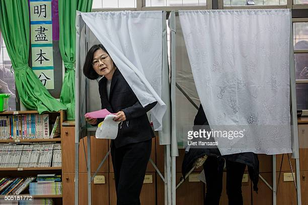 Democratic Progressive Party presidential candidate Tsai Ingwen walks out a booth after casting her ballot at a polling station on January 16 2016 in...