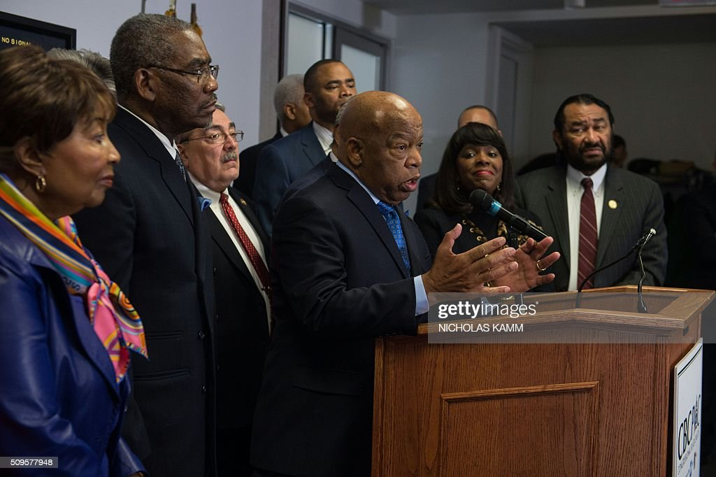 US Democratic Representative from Georgia John Lewis speaks as the Congressional Black Caucus Political Action Committee (CBCPAC) announces its endorsement of Democratic presidential candidate Hillary Clinton for the November election in Washington, DC, on February 11, 2016. / AFP / Nicholas Kamm