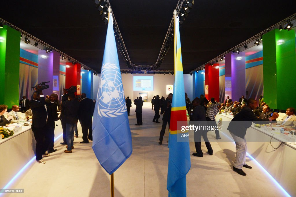 A Democratic Republic of Congo (L) and a United Nations flag (R) are pictured before a visit by UN secretary general ane World Bank President at the Parliament in Kinshasa on May 22, 2013. Ban Ki-moon wraps up a visit to Mozambique and arrives in Kinshasa on a key leg of his Africa trip centred on restoring peace in eastern Democratic Republic of Congo where a flareup in fighting over the past days has left 19 dead.