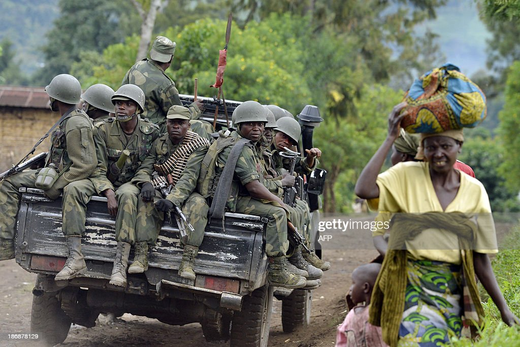 Democratic Republic of Congo Fardc regular army soldiers sit at the back of a pickup truck as they head towards the Mbuzi hilltop near Rutshuru on...