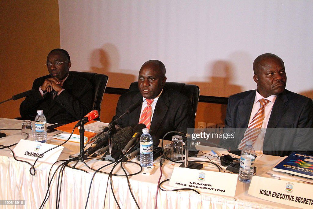 Democratic Republic of Congo Foreign Minister Raymond Tshibanda (L), Ugandan Defense Minister Crispus Kiyonga (C) and the head of the M23 Congolese rebels, Roger Lumbala, give a press conference on February 6, 2013 in Kampala. The government of the Democratic Republic of Congo and M23 rebels holding peace talks in Kampala on February 6 finalized a review of an earlier failed peace agreement, the first of four stages toward reaching a peace deal. M23 rebels were persuaded to withdraw from the key eastern city of Goma after a 12-day occupation, they still control large areas of territory just outside the strategic mining hub. The negotiations are the latest in several bids to end a long-running conflict that has forced hundreds of thousands of people in eastern DR Congo from their homes.