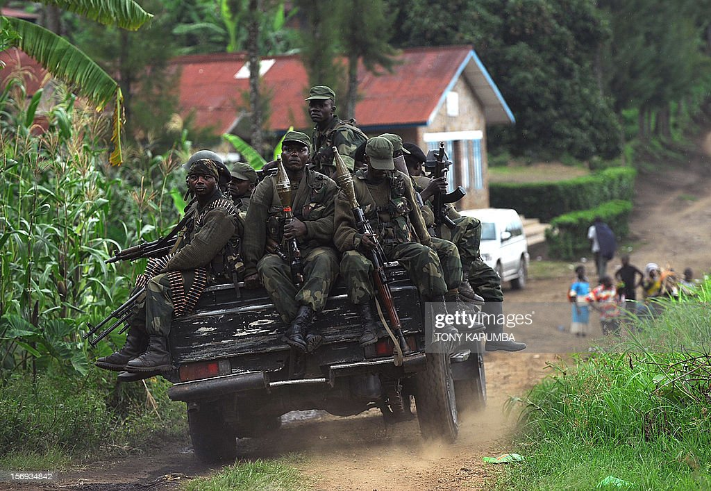 Democratic Republic of Congo government soldiers ride on the back of a truck, on November 25, 2012 in Minova, 70 kilometres south of Goma. Congolese rebels on Sunday rejected demands by regional governments to pull out of the eastern city of Goma to allow for peace talks aimed at preventing a wider conflict and halting a spiralling humanitarian catastrophe.President Joseph Kabila returned to Kinshasa from Kampala 'without meeting anyone from the rebellion' on Sunday despite suggestions of further talks in the Ugandan capital, where he took part in the regional summit. Rwandan President Paul Kagame and his Congo Republic counterpart Denis Sassou-Nguesso called Sunday on both the DR Congo government and rebels threatening to overthrow it to implement regional leaders' call to stop fighting and make peace . AFP PHOTO/Tony KARUMBA