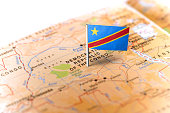 The flag of Democratic Republic of Congo pinned on the map. Horizontal orientation. Macro photography.
