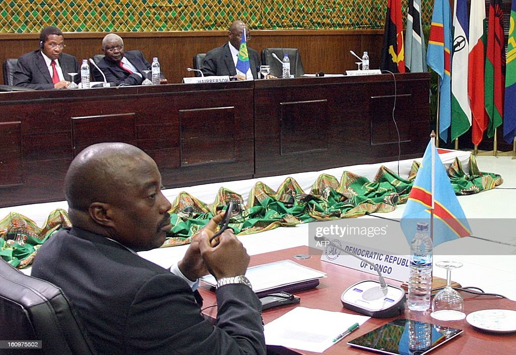 Democratic Republic of Congo President Joseph Kabila (L) atends an extraordinary Southern African Development Community (SADC) summit in Maputo on February 8, 2013 to discuss the deployment of peacekeepers to the Democratic Republic of Congo. The group was said to be at an advanced stage of military planning, but there was still disagreement about whether to send a stand-alone SADC force or join the United Nations mission. AFP PHOTO / FERHAT MOMADE