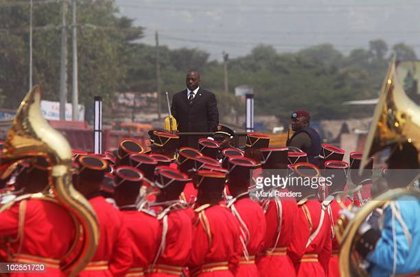 Democratic Republic of Congo President Joseph Kabila watches as marching bands pass by during the 50th anniversary parade marking the independence of...