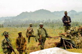 Democratic Republic of Congo regular army soldiers stand guard atop the Kanyesheza hill on June 15 near the border with Rwanda For DRC soldiers the...