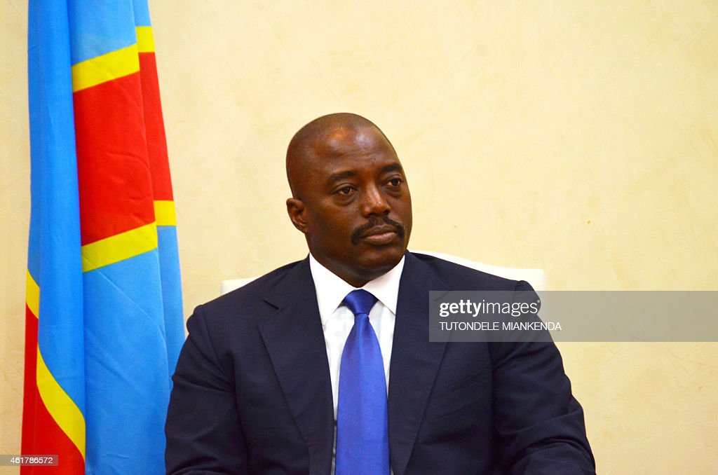 Democratic Republic of Congo's President <a gi-track='captionPersonalityLinkClicked' href=/galleries/search?phrase=Joseph+Kabila&family=editorial&specificpeople=467567 ng-click='$event.stopPropagation()'>Joseph Kabila</a> attends a meeting with his Angola's counterpart on January 19, 2015 in Kinshasa. Three people were killed in Kinshasa on Monday in clashes between police and thousands protesting moves to allow President <a gi-track='captionPersonalityLinkClicked' href=/galleries/search?phrase=Joseph+Kabila&family=editorial&specificpeople=467567 ng-click='$event.stopPropagation()'>Joseph Kabila</a> to extend his hold on power, a government source said. / AFP / TUTONDELE MIANKEN