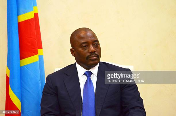 Democratic Republic of Congo's President Joseph Kabila attends a meeting with his Angola's counterpart on January 19 2015 in Kinshasa Three people...