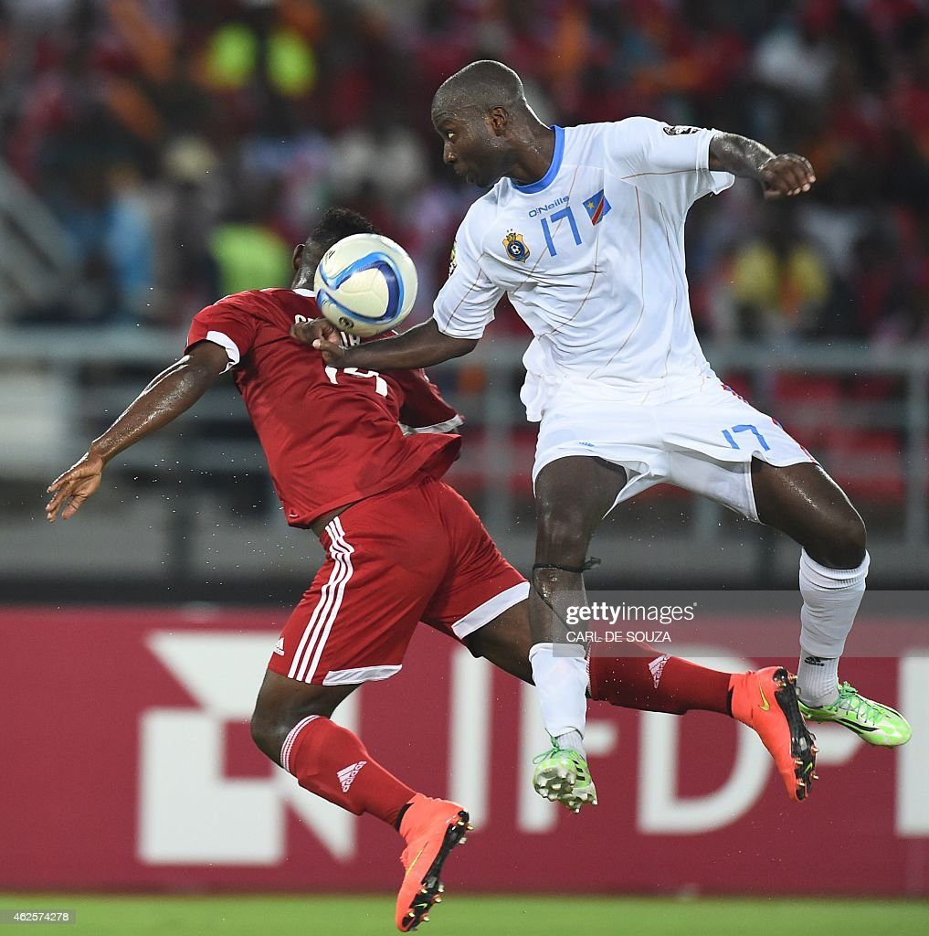 Democratic Republic of the Congo's defender <a gi-track='captionPersonalityLinkClicked' href=/galleries/search?phrase=Cedric+Mongongu&family=editorial&specificpeople=4305033 ng-click='$event.stopPropagation()'>Cedric Mongongu</a> (R) vies with Congo's midfielder Cessaire Gandze during the 2015 African Cup of Nations quarter final football match between Congo and Republic of the Congo in Bata, on January 31, 2015. AFP PHOTO / CARL DE SOUZA