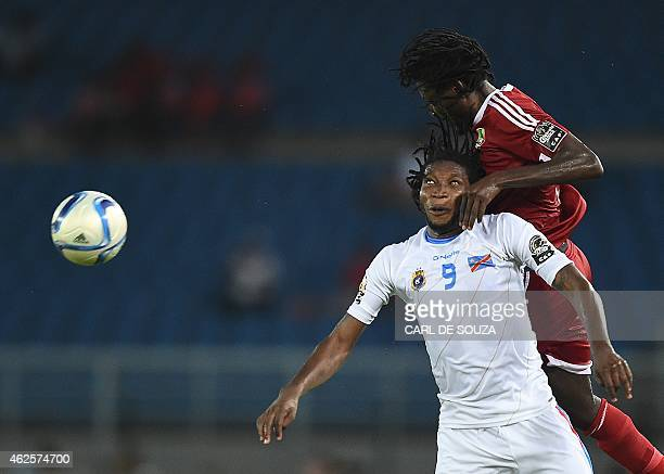 Democratic Republic of the Congo's forward Dieudonne Mbokani vies with Congo's defender Dimitry Davy Magnokele Bissiki during the 2015 African Cup of...