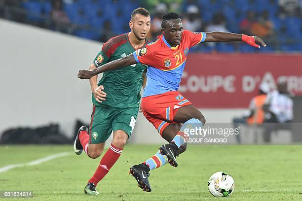 Democratic Republic of the Congo's forward Firmin Ndombe Mubele challenges Morocco's forward Omar El Kaddouri during the 2017 Africa Cup of Nations...