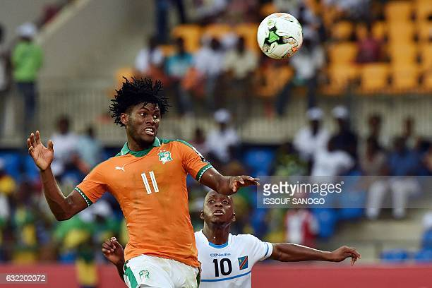 Democratic Republic of the Congo's midfielder Neeskens Kebano challenges Ivory Coast's midfielder Franck Kessie during the 2017 Africa Cup of Nations...