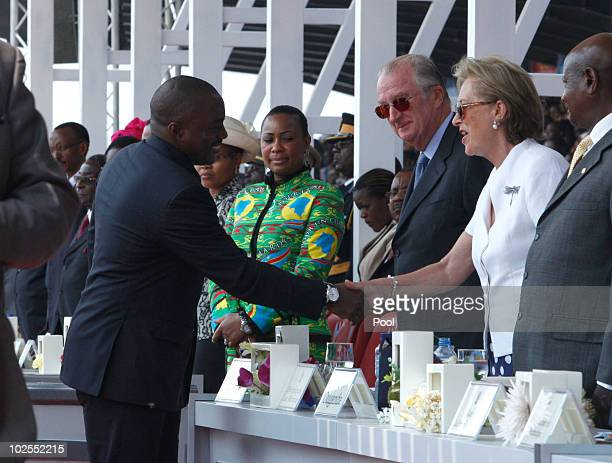 Democratic Repuplic of Congo President Joseph Kabila shakes hands with King Albert II of Belgium and Queen Paola of Belgium as they attend the 50th...