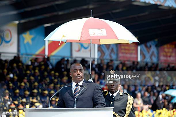 Democratic Repuplic of Congo President Joseph Kabila speaks as he attends the 50th anniversary parade marking the independence of the Democratic...