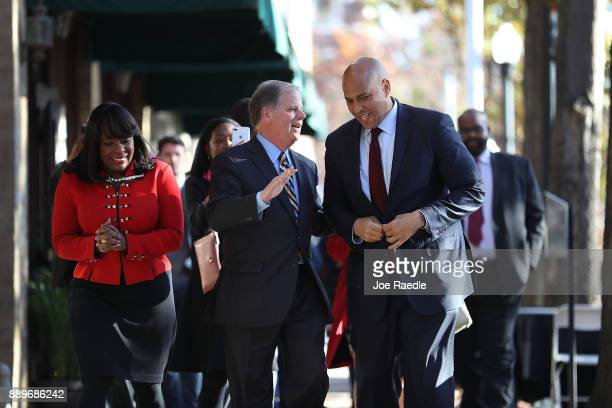 Democratic Senatorial candidate Doug Jones arrives with RepTerri Sewell and US Sen Cory Booker at a Jones for Senate Field Office on December 10 2017...