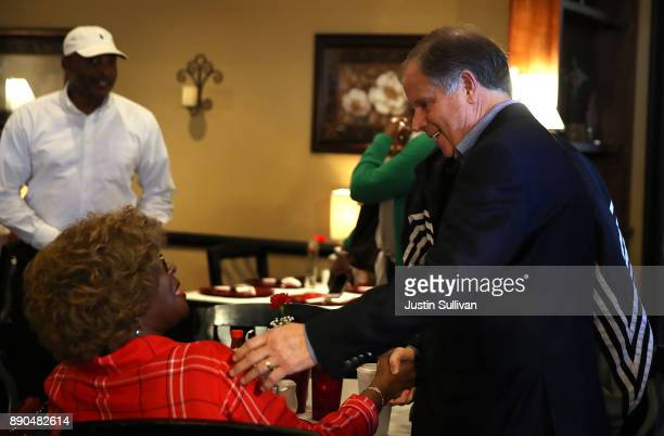 Democratic Senatorial candidate Doug Jones greet patrons during a campaign stop at Martha's Place on December 11 2017 in Montgomery Alabama Jones is...