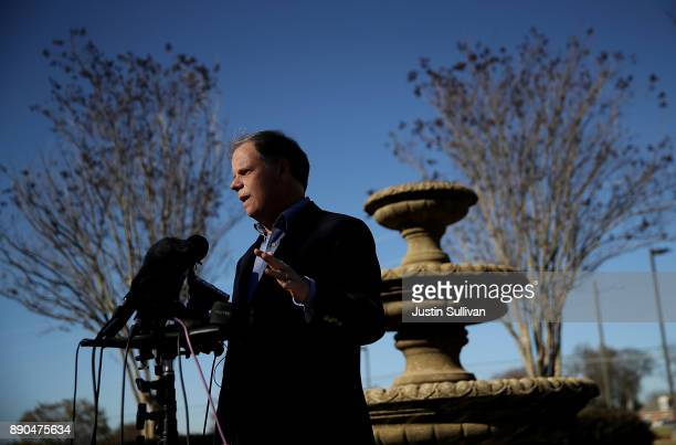 Democratic Senatorial candidate Doug Jones speaks to reporters following a campaign stop at Martha's Place on December 11 2017 in Montgomery Alabama...