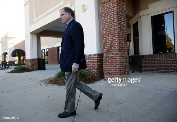 Democratic Senatorial candidate Doug Jones walks out of a campaign stop at Martha's Place on December 11 2017 in Montgomery Alabama Jones is facing...