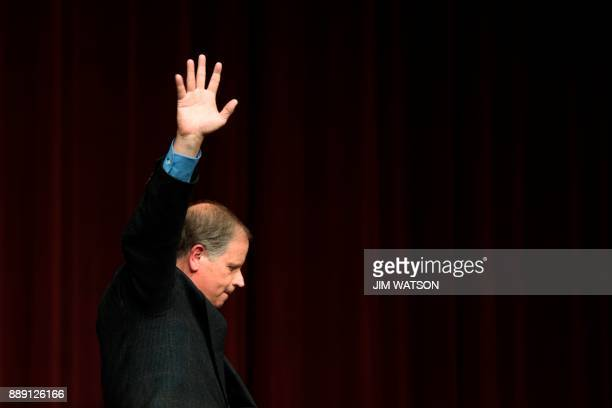 Democratic Senatorial candidate Doug Jones waves to supporters after speaking at a rally in Birmingham Alabama on December 9 2017 The Alabama race...